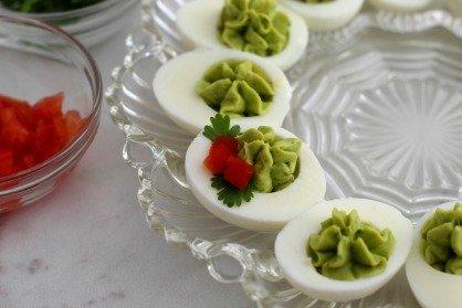 """Creamy Christmas """"Holly"""" Avocado Deviled Eggs"""