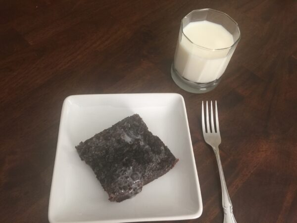 Oreo Brownie Slice on a White Plate with a Glass of MIlk