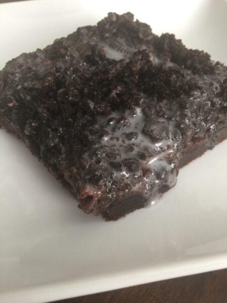 Single square Oreo Brownie closeup on a white plate